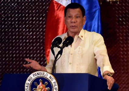 President Rodrigo Duterte gestures during a turnover ceremony of procured pistols for the Armed Forces of the Philippines (AFP) at the Malacanang presidential palace in metro Manila, Philippines July 18, 2017. REUTERS/Dondi Tawatao